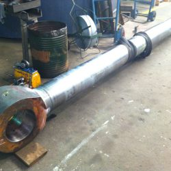 Hydraulic piston rod straightened prior to refurbishment